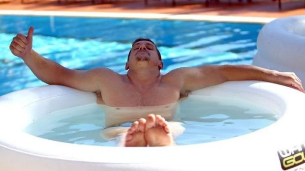 Cooling off: NSW back-rower Greg Bird soothes his aching muscles after a training run at the Blues' Coffs Harbour base ...