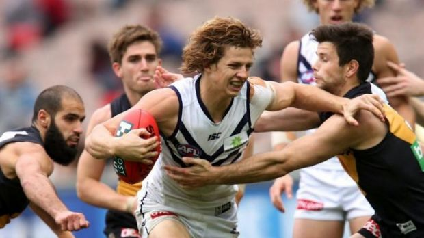 Nathan Fyfe tries to break out of the congestion.