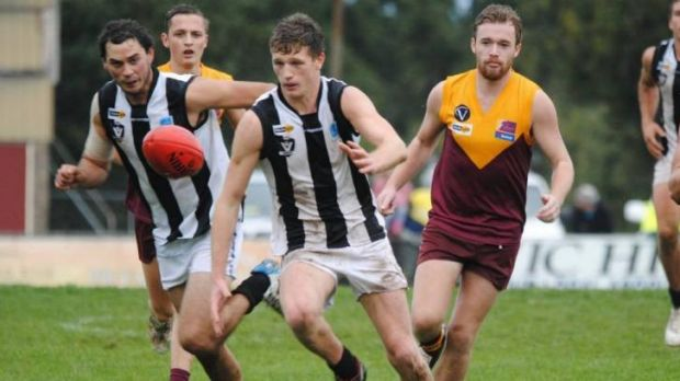 Trying: The Drouin Hawks (maroon and yellow) are battling tough times at the moment.