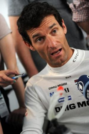 Mark Webber talks to the media at Le Mans.