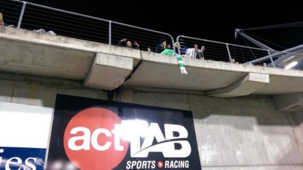 How could such a small scarf cause such a drama, hanging over the edge of the grandstand at Canberra Stadium.