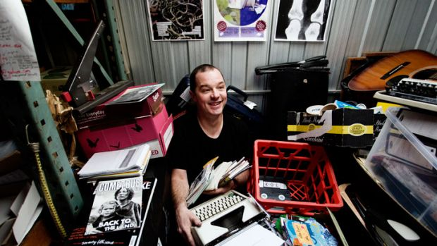 Zine fan Luke Sinclair in his storage shed surrounded by his collection.