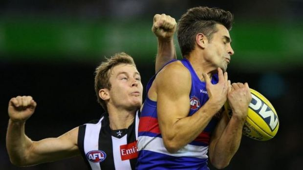 Daniel Giansiracusa of the Western Bulldogs attempts a mark ahead of Collingwood's Sam Dwyer.