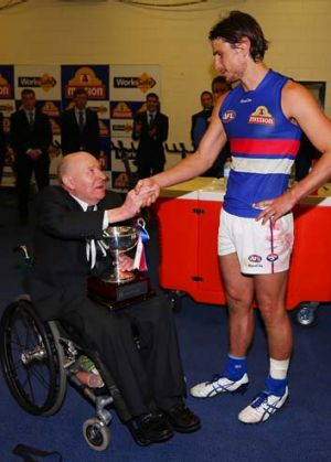 Cliff Wise presents the Robert Rose Cup to Ryan Griffen.