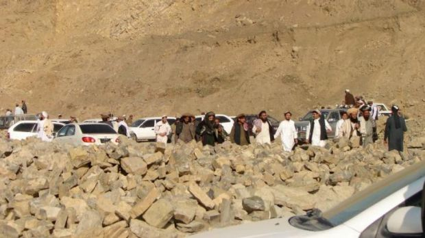 A group of suspected Pakistani Taliban flee from North Waziristan on Saturday.