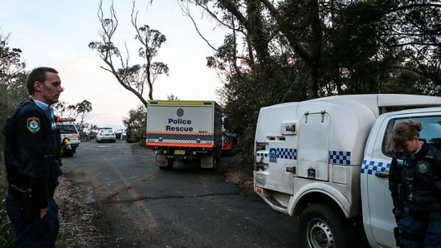 Police, forensic police and the SES at the crime scene.