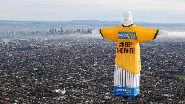 Words from on high: The Sportsbet balloon copy of Rio's Christ the Redeemer flies over Melbourne.