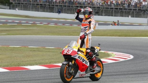 Marc Marquez does a celebratory lap after his win.