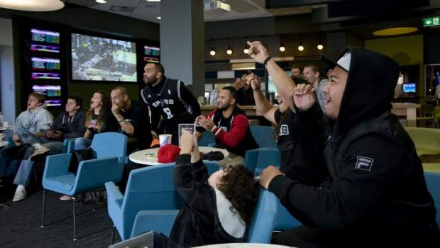 Patrick Mills' family and friends watch San Antonio Spurs vs Miami Heat in the NBA finals.