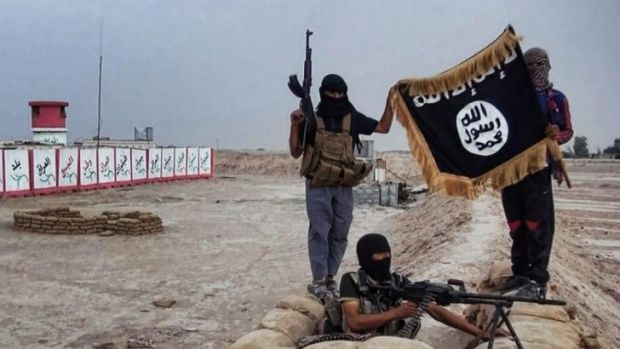 An image from a jihadist website shows ISIL militants at a captured checkpoint in Iraq's Salahuddin province.