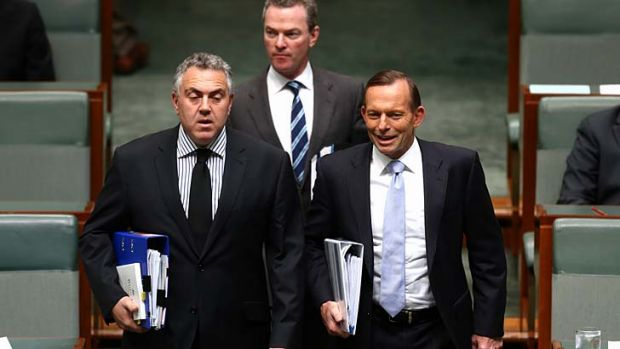 Under siege: Treasurer Joe Hockey, Christopher Pyne and Prime Minister Tony Abbott arrive for Question Time.