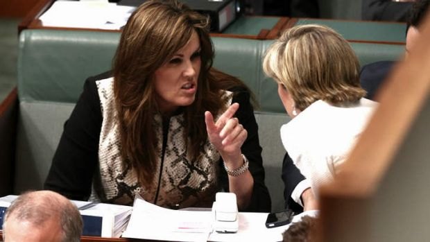 Tony Abbott's chief of staff Peta Credlin talks to Foreign Minister Julie Bishop during question time in Parliament on ...