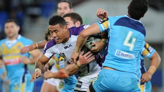 Wrapped up: Melbourne Storm's Ben Roberts is tackled on Monday night.