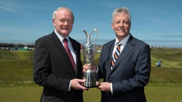 Northern Ireland Deputy First Minister Martin McGuinness and First Minister Peter Robinson hold the Claret Jug trophy at ...