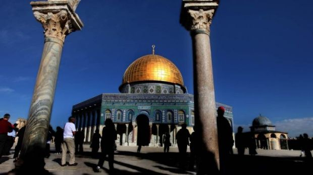 Tourists visit the holy site known to Jews as the Temple Mount, and to Muslims as Haram al-Sharif, or Noble Sanctuary, ...