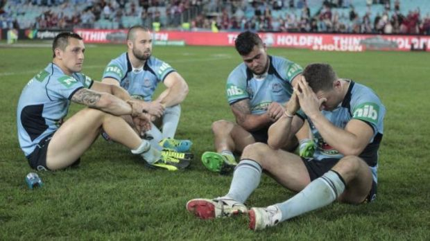 Despair: Mitchell Pearce, Aaron Woods, Andrew Fifita and Robbie Farah come to terms with defeat in 2013.