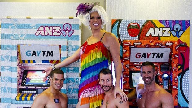 Penny Tration (centre) and friends pose in front of 'GAYTMS' at the ANZ bank in Oxford Street in Darlinghurst.