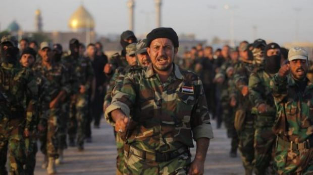 """Volunteers in the newly formed """"Peace Brigades""""?  in the southern city of Najaf."""