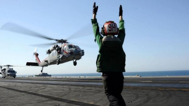 A US Navy Sea Hawk helicopter lands on the USS George H.W. Bush.