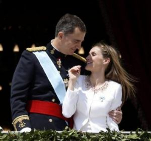Balcony scene: Spain's new King, Felipe VI, embraces his wife Queen Letizia.