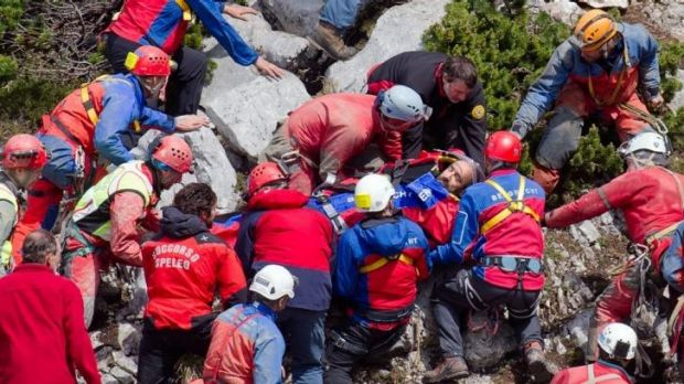 First light: Mountain rescuers carry Johann Westhauser out of the Riesending cave.