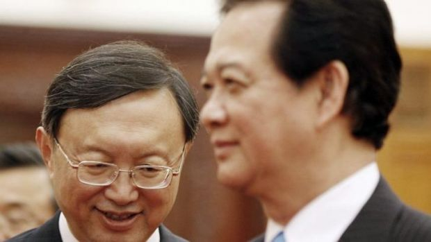 Chinese State Councillor Yang Jiechi (left) smiles during a meeting with Vietnamese Prime Minister Nguyen Tan Dung ...