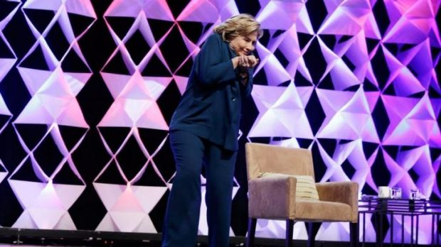 Hillary Clinton ducks after a woman threw an object towards her at a conference in Las Vegas in April.