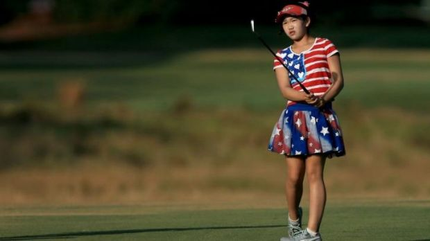 Eleven-year-old Lucy Li watches her shot on the 12th hole during the first round of US Women's Open.