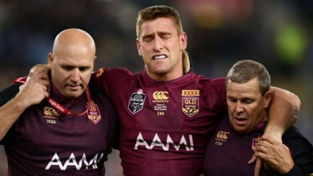 Brent Tate is helped off the field after sustaining an injury during Origin II on Wednesday.