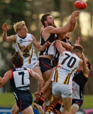 Max Gawn of the Casey Scorpions gets to the ball as Will Langford of the Box Hill Hawks goes up to contest.