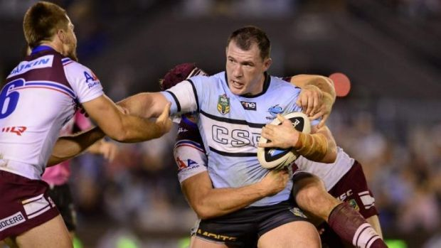 Cronulla captain Paul Gallen tries to fend off the Manly defence.