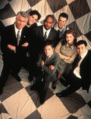 The cast of Spin City - Alan Ruck is at the back on the right with glasses.