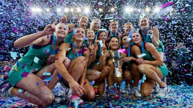 The Vixens celebrate with the ANZ championship trophy.