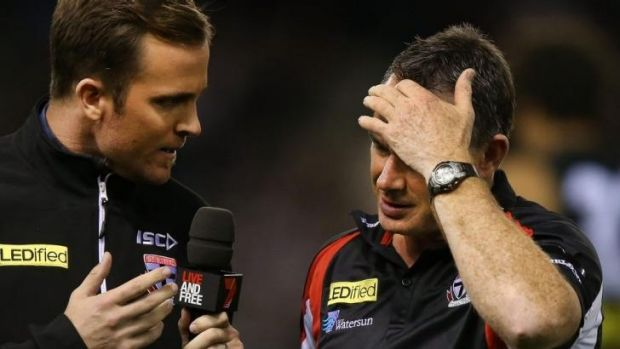 Saints coach Alan Richardson (right) is interviewed at three-quarter-time on Sunday.