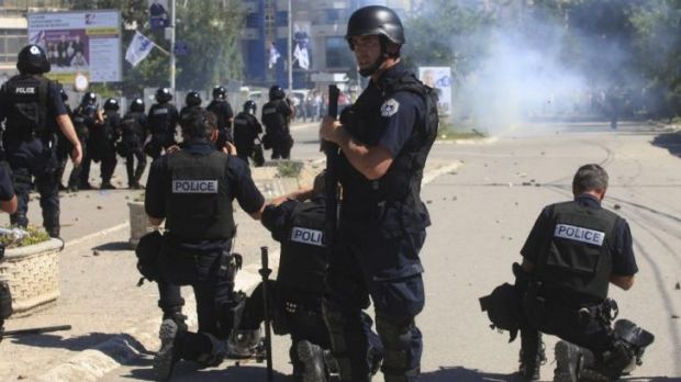 Police release tear gas at Kosovo Albanian demonstrators in Mitrovica on Sunday.