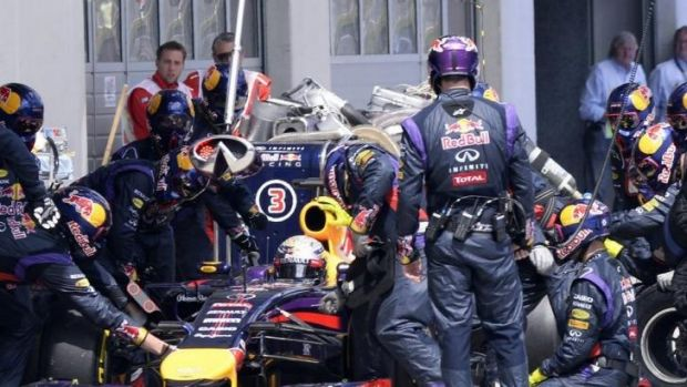 Sebastian Vettel gets some pit-stop assistance during the Austrian F1 Grand Prix