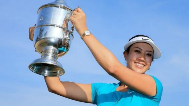 Michelle Wie holds the trophy after her victory at US Women's Open.
