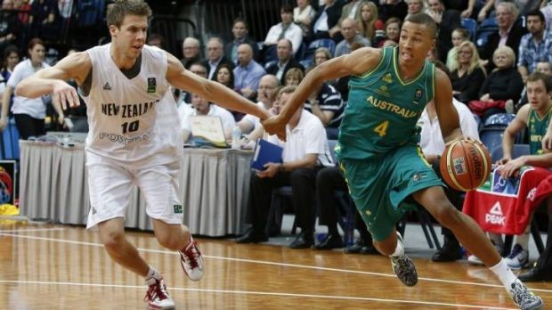 Dante Exum (right) in action for the Boomers against New Zealand last year.