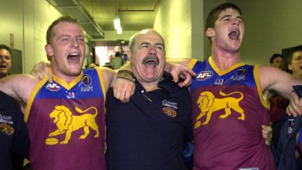 Michael Voss, Leigh Matthews and Jonathan Brown sing the song after a win.