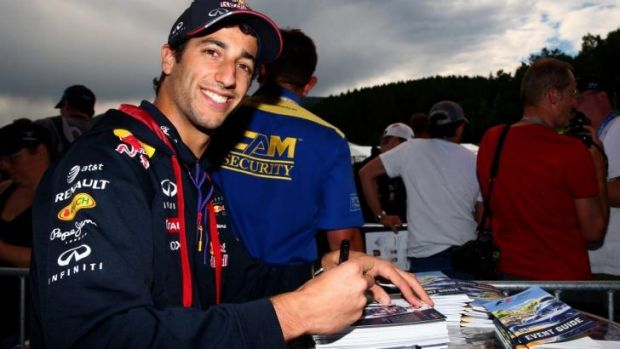 Daniel Ricciardo signs autographs ahead of the Austrian Formula One Grand Prix.