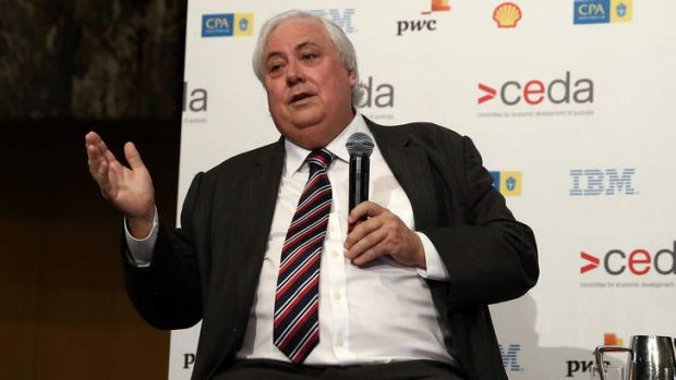 Political business: Clive Palmer addresses a conference on Monday.