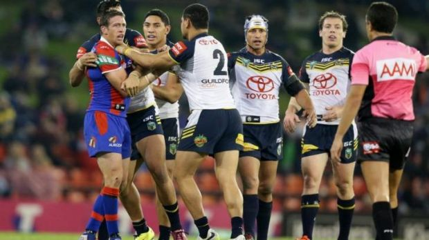 Fight Knight: Newcastle skipper Kurt Gidley gets to grips with Cowboys winger Matthew Wright.