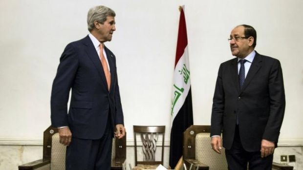 US Secretary of State John Kerry meets Iraqi Prime Minister Nouri al-Maliki, right, at the Prime Minister's office in ...