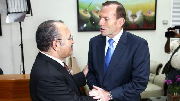 Tony Abbott shakes the hand of his PNG counterpart Peter O'Neill in March.