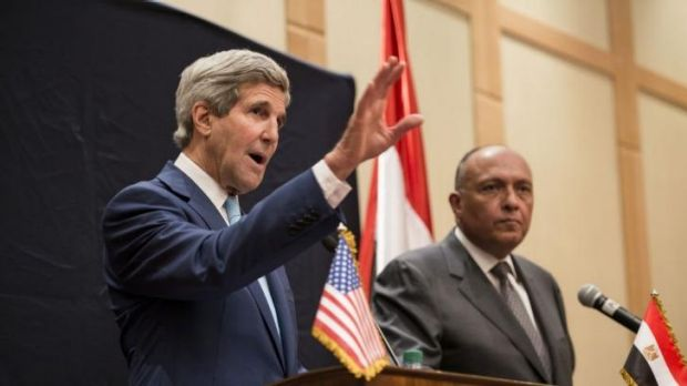 Egypt's Foreign Minister Sameh Hassan Shoukry (right) and US Secretary of State John Kerry in Cairo.