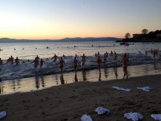 Swimmers hit the icy water of the Derwent River for Dark Mofo's Nude Solstice Swim.