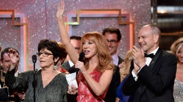 Ceremony host Kathy Griffin, centre, with cast and crew of 'The Young and the Restless', which won Outstanding Drama Series.