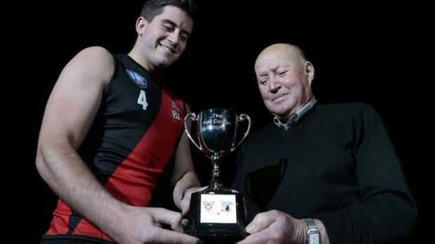 Aaron Bruce with former Manuka Football Club player Jacko Pini and the Neil Conlan Trophy.  Eastlake will be holding a ...