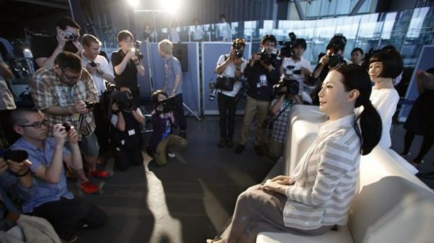 The new face of newsreaders? Photographers gather around female-announcer robot called Otonaroid, second right, and a ...