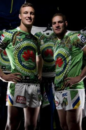 Jack Wighton, left, and Brenko Lee model Canberra's indigenous round jersey.
